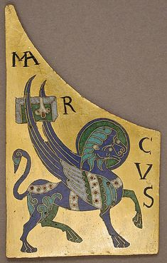 Plaque with the Symbol of the Evangelist Mark Date: ca. 1100 Geography: Made in, Conques, France Culture: French Medium: Copper: cut and gilt; champlevé and cloisonné enamel: black, lapis and lavender blue, turquoise, green, red, white, pinkish white. Dimensions: Overall: 4 x 2 7/16 x 1/8in. (10.1 x 6.2 x 0.3cm) Accession Number: 17.190.426 Metropolitan Museum of Art