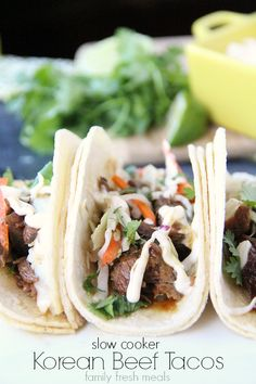 Slow Cooker Korean BBQ Beef Tacos are easy to make – all with a little help from Campbell's Dinner Sauces. Plus, the flavors in this dish are amazing! Recipe and photo by blogger at www.FamilyFreshMe...