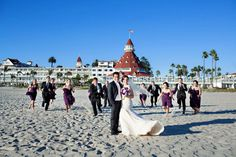 Hotel del Coronado beach wedding. Purple and white elegance.