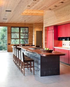 I love the island top!   The live-edge walnut tree slab used for the kitchen island adds an organic note.