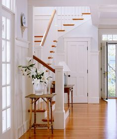 I can really see this as my dream entryway/staircase. I love how the staircase has the first few stairs, a landing, more stairs, another little landing, and then you finish your upward journey. I also love how bright this entire area is.