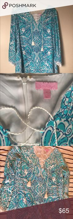 Lilly Pulitzer M. Tunic Dress-Sea Blue Tipsy Tusks Lilly Pulitzer Ashby Lace-Up Tunic Dress in the print Sea Blue Tipsy Tusks. Women's size Medium with 3/4 length sleeves. Worn twice to a pageant and a wedding so it's in perfect condition! Lilly Pulitzer Dresses Long Sleeve