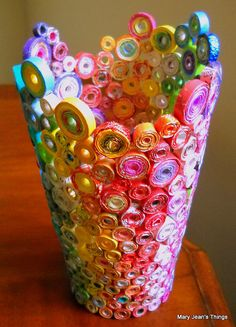 Upcycled Rainbow Vase Sculpture made from Magazines, Candy Wrappers, Catalogs & Coupon Circulars