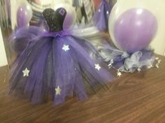 centerpieces for a quinceanera in purple black and silver with stars