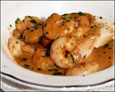 Court Of Two Sisters, New Orleans: Recipes for their BBQ Shrimp and their Courtyard Bread Pudding with Whiskey Sauce.
