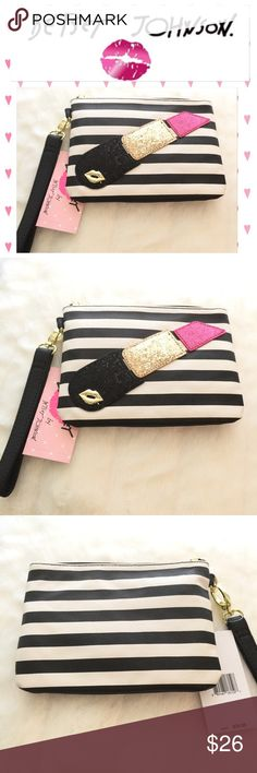 Betsey Johnson  Lipstick Wristlet Black & White Black and white striped Wristlet with glittering ✨ lipstick on one side.  Wristlet strap attached.  Would make a great bag-inside-a-bag, a great cosmetic bag or just a fun Wristlet.  Plenty of room for wallet, keys, cosmetics, phone etc.  Hard to find!  Bundle for discount See listing on bundles for best discount and free shipping!! Brand new with tags, never used- in pristine condition. Amy Betsey Johnson Bags Clutches & Wristlets