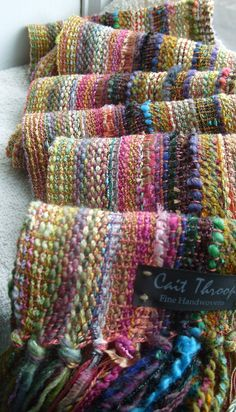 Hand Woven Scarf [Design results from multicolored art yarn warp and a solid, neutral-colored weft yarn. wsh]
