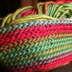 Making a rainbow-striped purse out of a silk blended wool.