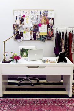 Home workspace with clothing rack and moodboard