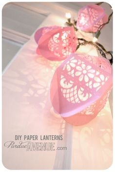 These pretty paper lanterns were made using Samantha Walkers Egg Box cut files now available at jessicasprague.com! They are compatible with many different cutters.