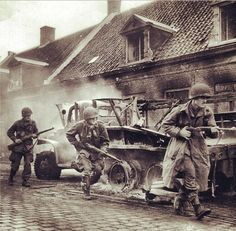 Soldiers of the 101st Airborne Division in action during Operation Market Garden. 1944