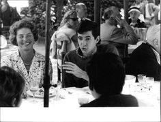 Vintage photo of Anthony Perkins and Ingrid Bergman enjoying with friends, sitt