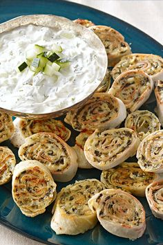 Take these Cheesy Greek Pinwheels to any summer concert or picnic. Made with tortillas, feta and spinach, these are the perfect snack for an outdoor gathering. #recipe