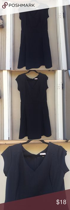 Black Cap Sleeve dress WITH POCKETS Black merona dress size large. Nice thick black material with cap sleeves and v neck. HAS POCKETS. Invisible zipper in the back. Never worn, but has lint (as seen in pictures) from hanging in closet all these years. Perfect for when you don't know what to wear. Simple lbd that is very flattering as it flares. Falls about knees (I'm 5'4) Did I mention it has POCKETS!?!? Merona Dresses Mini