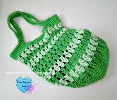 Crochet your way to one of the most convenient free crochet bag patterns out there. This sassy and striped free crochet bag pattern is hooked up in two different colors of worsted weight yarn, making it sturdy and stylish at the same time.