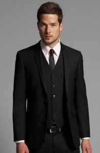 Gary wants a solid black suit, black vest, white shirt, and black tie..with black and white oxfords.