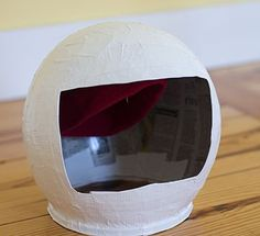 Astronaut helmet - Papier mache over a balloon, cut out face, embroidery hoop on…