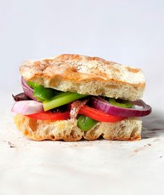 "This simple sandwich, whose name translates to ""bathed bread,"" is a picnic classic for good reason: unlike traditional sandwich spreads (i.e. mayo), which don't pack well, the vinaigrette dressing gently moistens the crunchy bread and deepens in flavor during travel."