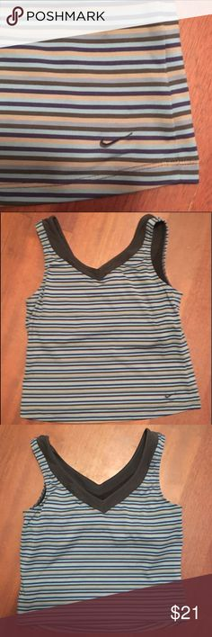 Support the tatas! Nike striped dri sports top Nike sports top with dry fit, size medium. Tank with stripes - mainly blue and black colors. Non smoking home, gently used. Nike Tops Tank Tops