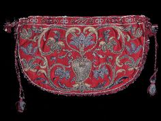 England    Bag, 17th century    Silk, weft-float faced satin weave; embroidered in silk threads and gilt strip wound around a silk fiber core in couching and padded couching stitches; looped fringe attached in seams; draw-strings: silk, braid, terminating in tassels, interlaced through holes cut along upper edge; lining; silk, plain weave  10.3 x 17.7 cm (4 1/8 x 7 in.)  Extended width (with tassels and drawstrings): 37.4 cm (14 3/4 in.)