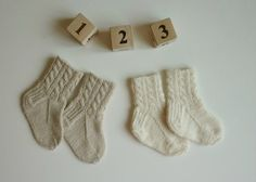 Lovely hand knitted baby socks in white, sand or light purple colors for a baby girl or baby boy ! The socks are knitted from a hight