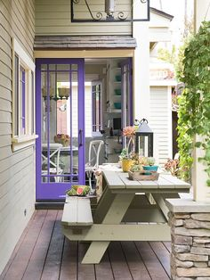 These purple doors are everything! Get more colorful touches for outdoor decorating here: http://www.bhg.com/home-improvement/porch/outdoor-rooms/colorful-backyard-decorating-ideas/