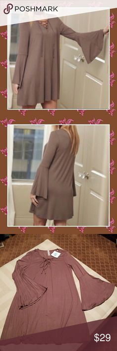 ❤BOHO BELL SLEEVED DRESS ❤ INFINITY RAINE SIZE MED  TAUPE COLOURED BOHO DRESS  WITH BELL SLEEVES  TIE UP FRONT MADE IN THE USA 95% RAYON 5% SPANDEX  BUST MEASURES 19 INCHES LAYING FLAT ! SLEEVE LENGTH 17 INCHES  DRESS LENGTH 34 INCHES CUTE WITH OVER THE KNEE BOOTS! Infinity Raine Dresses