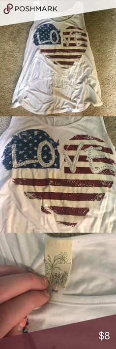 White American Flag Crop Tank Top White crop tank top with American flag heart in the center! Never worn before! Smoke free home! I wash all my products before I ship! Charlotte Russe Tops Tank Tops
