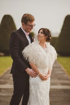 Bride Jade wore a feather cape and a Maggie Sottero gown for her romantic and elegant country house spring time wedding. Photography by Alexa Penberthy.