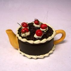 Black Forest Cake teapot in shape of chocolate cake topped with cherry fruit, ceramic