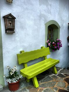 This chunky wooden bench looks great painted a funky colour!