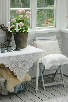 dream cottage - geraniums, white, lace, embroidery and sunny window leading to the garden outside.