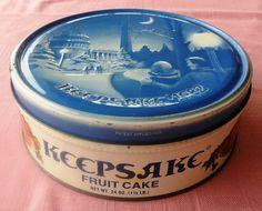 "Lata navideña de fruitcake Keepsake bien viejita / 1982 Keepsake Christmas fruitcake tin can blue and white 7"" across"