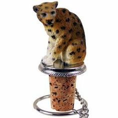 """Leopard Bottle Stopper by Conversation Concepts. $12.49. Pewter Base with chain and Ring to keep it with the bottle.. Satisfaction Guaranteed. Made of Poly Resin and Hand Painted.. Wine Save Cork. Approximately 1.5 - 2 inches.. A pewter based cork bottle stopper with a 2"""" leopard designed to fit any standard size bottle.  Comes with it's own velvet drawstring pouch, perfect for gift giving!  Total height of bottle buddy is approximately 3 1/2"""" high.   We have over 198 ..."""