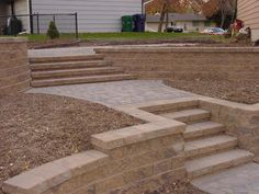 patio design ideas in Minnetonka, Mn. paving stone cobblestone brick stone boulder wall concrete block in backyard patios flagstone Retaining Wall Steps, Backyard Retaining Walls, Retaining Wall Design, Backyard Patio, Garden Stairs, Patio Wall, Yard Design, Outdoor Landscaping, Outdoor Living