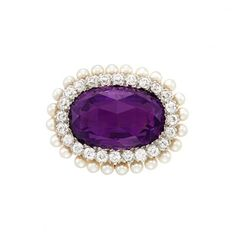 Antique Gold, Amethyst, Diamond and Pearl Brooch, Tiffany & Co. One oval rose-cut cabochon amethyst ap. 40.00 cts., 24 old European-cut diamonds ap. 1.90 cts., 24 pearls ap. 3.0 mm., signed Tiffany & Co., c. 1900.
