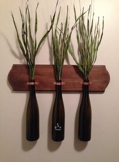 Three empty and clean wine vases look beautiful when mounted with copper onto wood, making a mounted trio of vases. Try making — or buying — your own!
