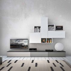 Contemporary TV unit composition Swift by Favero, features 3 wooden base units, 3 wall mounted units and 3 wall mounted bookcase elements
