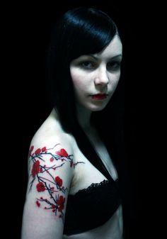 red cherry blossum tattoo arm