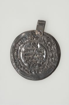 """Viking age / Silver.Dirhem The original is a """"Christian imitation"""" (note the cross above the inscription) of an Islamic dirham. Probably minted in Kiev, early 10th century. Vårby, Huddinge, Södermanland, Sweden."""