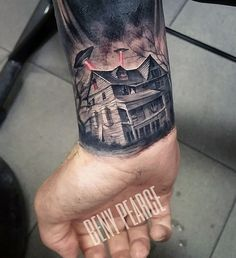 Sweet alien wrist tattoo of UFO's sucking people out of a home by artist Beny Pearce.