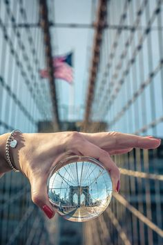 brooklyn.bridge.two - Follow us on Twitter: https://twitter.com/ph_fotografie Another shot of New Yorks Brooklyn Bridge - one of New York Citys most famous landmarks and always worth a visit. I used the same glassball like i did on this photo: http://500px.com/photo/65926089 For everybody who might be interested: Yes, i used photoshop to re-reverse the stuff inside the ball. Yes, this is made out of one picture. One shot only. No, this is not a reflection, it is a see through glassball. Tha