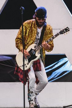 Performing with his band Thirty Seconds to Mars in West Palm Beach in Florida, Jared Leto wore a sequin bomber jacket, floral embroidered track pants and sneakers with tiger embroidery from Gucci Spring Summer 2017 by Alessandro Michele.
