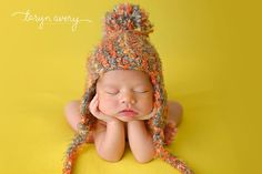 Soft and fuzzy hat with earflaps and pompom.