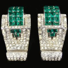 Mazer Pave Baguettes and Invisibly Set Emeralds Pair of Deco Scrolled Pin Clips