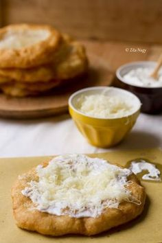 THIS SUMMER!  Lágnos: Deep-fried Hungarian flatbread topped with sour cream, cheese, and garlic butter | Zizi's Adventures - had this tasty treat outside Budapest  Ok. So I'm unlikely to make this, but I can remember it fondly until I go back.