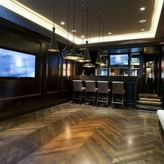 Michael Abrams - basements -gameroom chevron hardwood floors, dark stained oak hardwood, oak