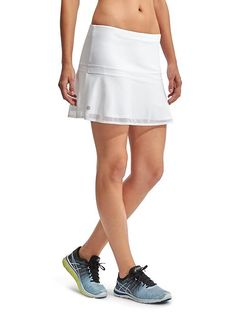 Upbeat Skort - The stretchy, breathable skort for all your high energy workouts with a mesh overlay and internal short that features money and ball pockets.