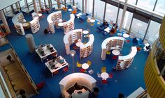 Modern Library. Social interaction and learning are encouraged by the seating and the circular shelves offer privacy.