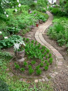 The recycled brick path makes use of broken pieces to help decrease its width and terminate it with a fiddlehead-shaped finale
